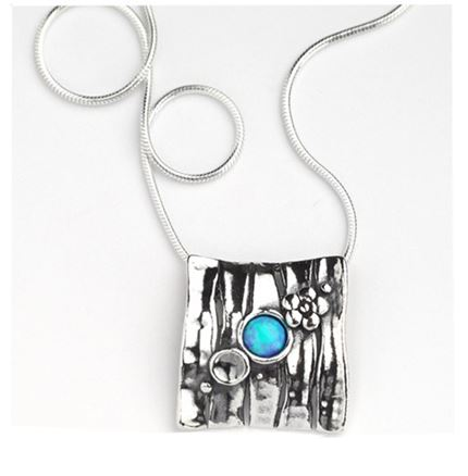 square pendant with small designs and round opal stone